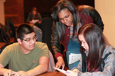 Jenny Rohl/The News A member of the Black Student Council assists fellow students during the council's trivia night.