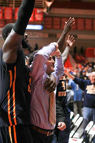 Jenny Rohl/The News Head Coach Steve Prohm and senior forward Jonathan Fairell raise their hands in celebration of their win against the Redhawks