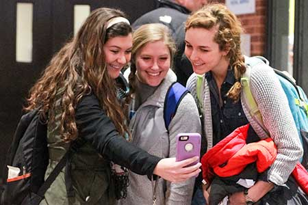 Jenny Rohl/The News Taylor Chadduck (left), junior from O'Fallon, Mo., Hannah Weber (center), sophomore from Metropolis, Ill., and Carley Sommer (right), junior from O'Fallon, Mo., take a selfie.