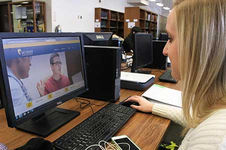 Kalli Bubb/The News Maggie Hagan, junior from Henderson, Ky., looks at the new murraystate.edu website, which was launched Feb. 6.