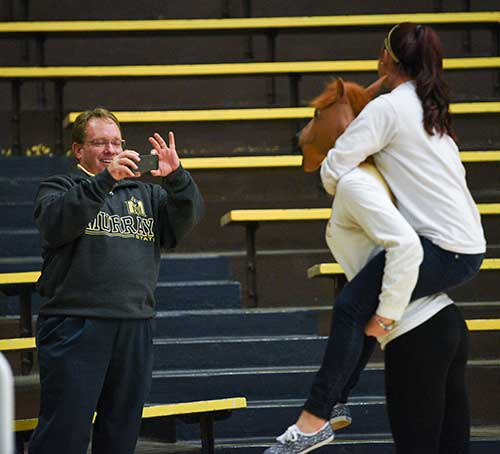 Kory Savage/The News President Bob Davies photographs two students during the OVC volleyball tournament championship game at Racer Arena Nov. 12.