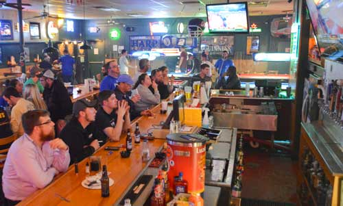 Hannah Fowl/The News People watch TV at Nick's Sports Pub, a popular spot to drink in Murray.
