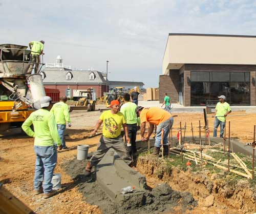 Haley Hays/The News Construction workers work outside of Panera Bread, which is predicted to open in about a month.