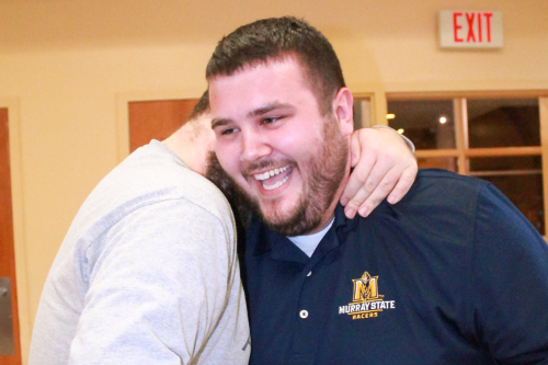 Credit: Jenny Rohl/The News Caption: Nathan Payne (left) embraces Clint Combs (right) after the election results were announced.