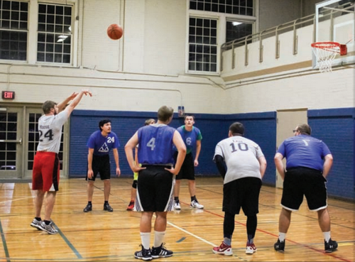 Nicole Ely/The News A Team Lob City player throws a free throw during an intramural game.