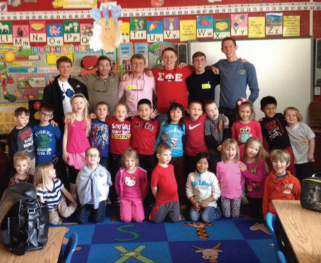 Photo courtesy of Robin Brown Brothers of Sigma Phi Epsilon spent Feb. 26 reading Dr. Seuss books to children at Murray Elementary School.