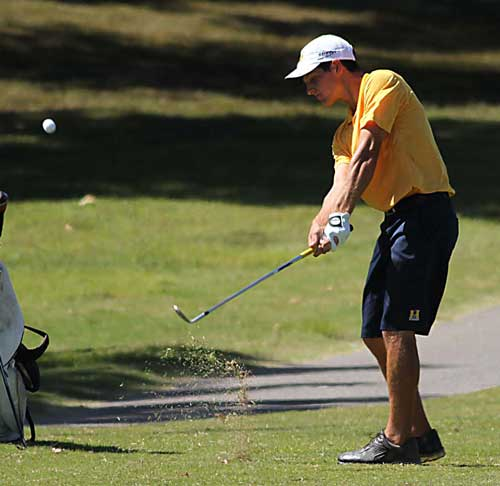 Photo Courtesy of Dave Winder Sophomore Matthew Zakutney, from Paducah, Ky., sends the ball into hole nine.