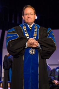 President Bob Davies stands on the stage of Lovett Auditorium Friday during his investiture. Fumi Nakamura/The News