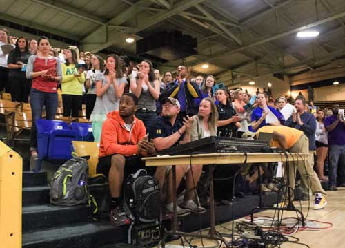 Kalli Bubb/The News Students fill Racer Arena to take part in the Women Center's annual Take Back the Night rally Monday night.