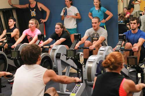 Jenny Rohl/The News Members of the rowing team, one of the University's four club sports, practice using rowing machines.