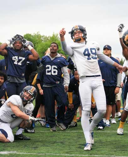Kalli Bubb/The News Senior kicker Carson Greifenkamp demonstrates kicking during their spring game April 24.