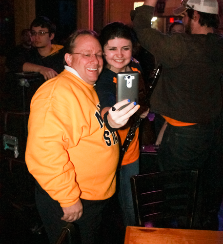 Jenny Rohl/The News President Bob Davies takes a selfie with a member of the Racer Pep Band at Tequila Cowboy before the men's basketball OVC Championship.