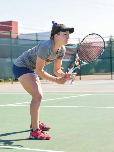 Kory Savage/The News Junior Megan Blue prepares for her singles match against Jacksonville State on April 11.