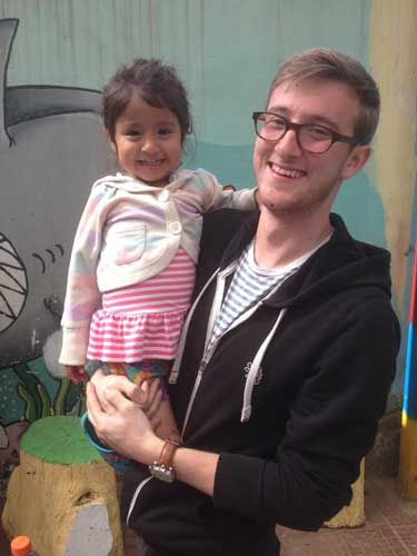 Photo courtesy of Aaron Peck Aaron Peck, senior from Shelbyville, Ky., poses with Hilda, a Guatemalan orphan.