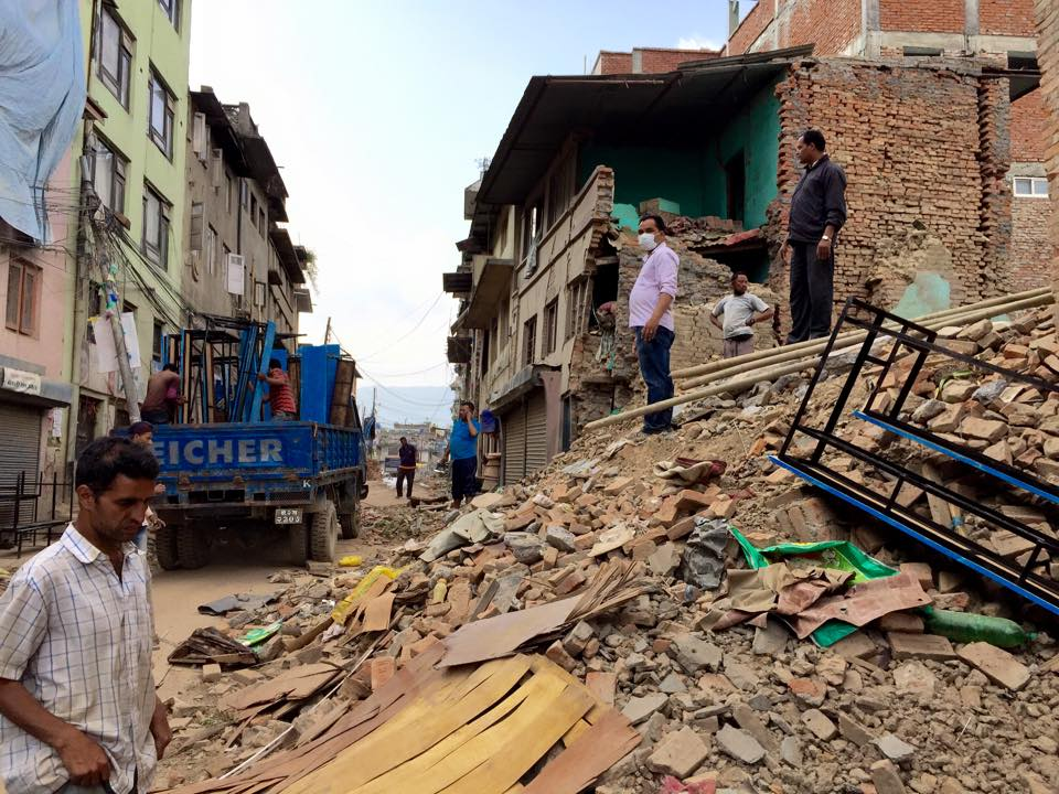People stand on rubble after the second earthquake to hit Nepal in two weeks. Photo courtesy of Ryan Brooks.