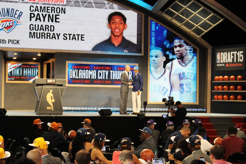 Mallory Tucker/The News Cameron Payne shakes NBA Commissioner Adam Silver's hand after being picked 14th overall by the Oklahoma City Thunder.