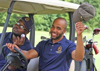 Photo Courtesy of Murray State Athletics Graduate assistant, Jewuan Long drives the golf cart during the Hoopalooza golf tournament on August 8.