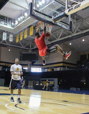 Mallory Tucker/The News Former Racer basketball player, Isaiah Canaan makes a dunk for his visit at Hoopalooza. Canaan now plays for the Philadelphia 76ers.