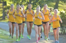 Chalice Keith/The News Led by senior Emma Gilmore from Locks Heath, England, the women's cross country team runs on Miller Memorial Golf Course to practice for their 2015 season.
