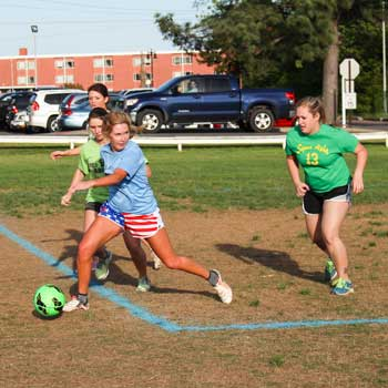 Nicole Ely/The News Mallory Tucker, senior on Alpha Delta Pi's spring soccer intramural team, makes a pass during their semi-final game against Sigma Alpha.