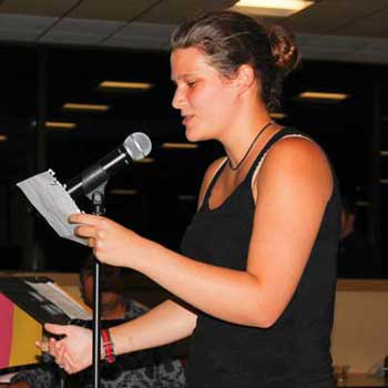 """McKenna Dosier/The News Michele Sumner, sophomore from Jackon, Tennessee, performed her poem, """"In Another Life,"""" at the Mocktails Slam last Thursday night."""