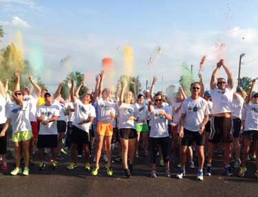 Photo courtesy of Kevin Spengle Last year's participants celebrate the start of the color run and celebrate the money they raised.