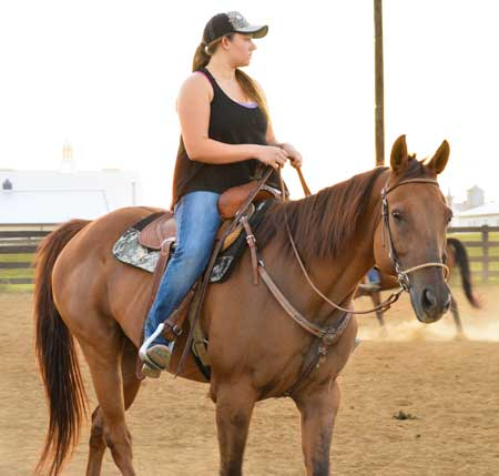 Emily Harris/The News Jessica Roy, senior from Vera Cruz, Pennsylvania, rides her horse during practice Tuesday night.