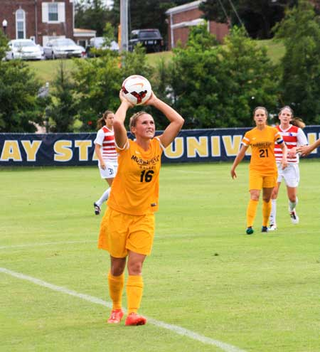 Kalli Bubb/The News Racheal Foxley, senior defender and midfielder, throws the ball back into play during the Racers game against Louisiana Tech Friday.