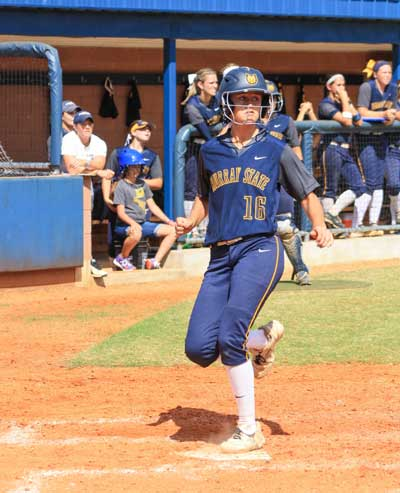 Kalli Bubb/The News Freshman Leah Kesel scores one of 12 Racer runs during doubleheader Sept. 20.