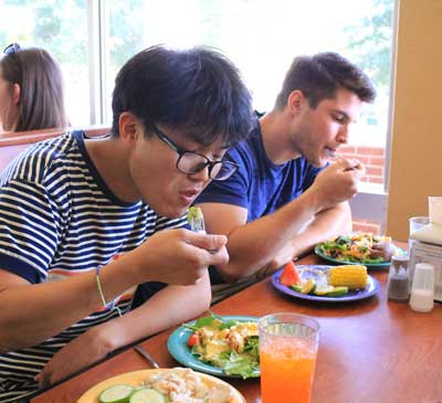 Jenny Rohl/The News Wonsu Kim, graduate student from South Korea, and Deric Hyman, junior from Shelbyville, Kentucky, enjoyed the Harvest Dinner at Winslow Dining Hall Wednesday night.