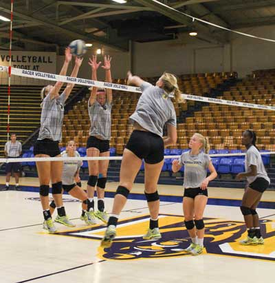Nicole Ely/The News Racer volleyball practices before the Holiday Inn Classic, which will be held on Sept. 11-12.