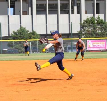 Nicole Ely/The News Senior pitcher J.J. Francis pitches during a practice before their first fall game on Sept. 13