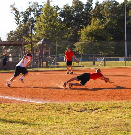 Nicole Ely/The News A member of the Alpha Sigma Phi team dives to save the ball and strike out a member of the Sigma Chi team.