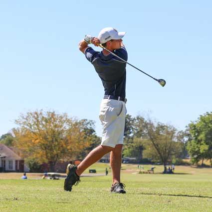 Nicole Ely/The News Matthew Zakutney, junior from Paducah, Kentucky, finishes his swing on the fairway.