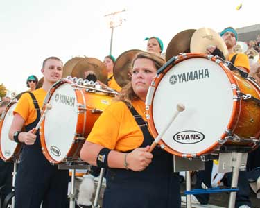Jenny Rohl/The News Drum line members look at racer band director, John Fannin, for its cue during Thursday night's game against Kentucky Wesleyan.