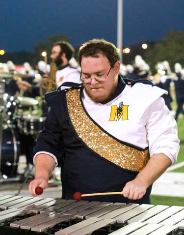 Jenny Rohl/The News Xylophone player, Jacob Therin, concentrates on Fannin's direction during the halftime performance.