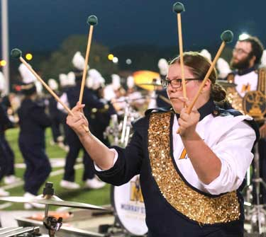 "Jenny Rohl/The News Xylophone player, Katherine Holler, plays ""Uptown Funk,"" during its halftime performance."