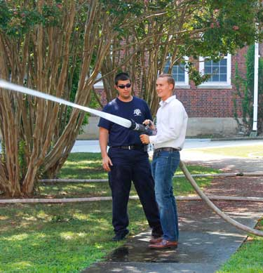 McKenna Dosier/The News Josh Reed, graduate student from Harrisburg, Kentucky, learns to use a firehose.