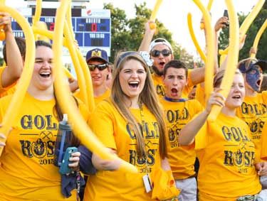 Nicole Ely/The News Freshman rally before the football game Thursday to rush the field for the second annual Gold Rush event hosted by Racer Athletics.
