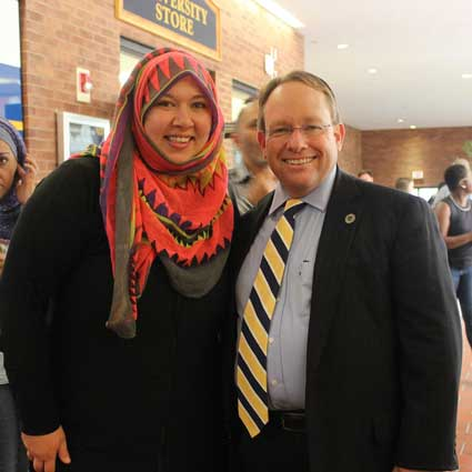 Photo courtesy of the Muslim Student Organization President Bob Davies and a student pose during last week's celebration of cultures.