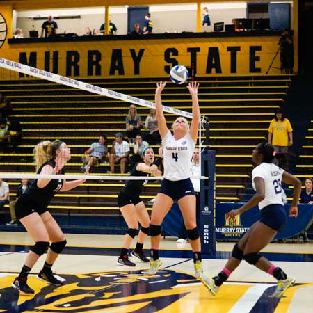 Zachary Maley/The News Sam Bedard, senior from Breese, Illinois, prepares to set Olivia Chatman, sophomore from Richmond, Texas, for a spike in Murray State's sweep on Austin Peay State Wednesday at Racer Arena.