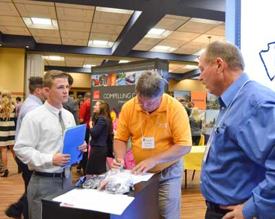 Emily Harris/The News An Occupational Safety and Health major, Mathew Cardani, sophomore from New Philadelphia, Ohio, met with Flint Howard and Tim Wallin, representatives from Flintco, during the STEM Career Fair Wednesday.