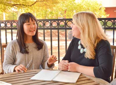 Emily Harris/The News Brianna Taylor, junior from Marion, Illinois and Hyejin Cho, freshman from Gwanju, South Korea, became friends after joining the English as a Second Language conversation partner program at Murray State.