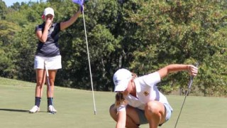 Nicole Ely/The News Sydney Trimble lines up her putt at the Murray State Invitational.