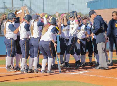Jenny Rohl/The News The Racers celebrate the end of their fall season against Heartland Community College on Oct. 16.