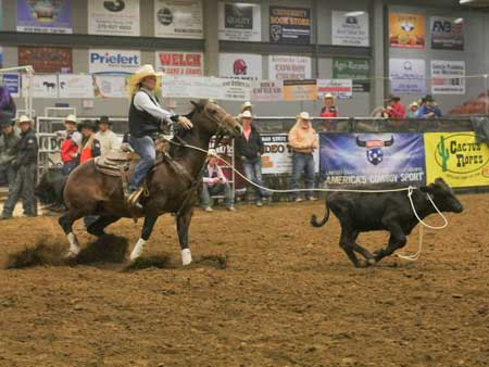 Jenny Rohl and Chalice Keith/The News Competitor competes in calf roping.