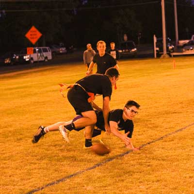 Nicole Ely/The News Phi Kappa Tau player defends Diaper Dandies receiver on incomplete pass.