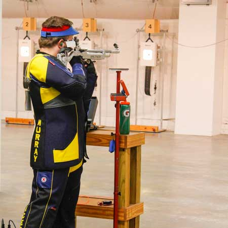 McKenna Dosier/The News A rifle member takes the standing position before their first home match against UT Martin.