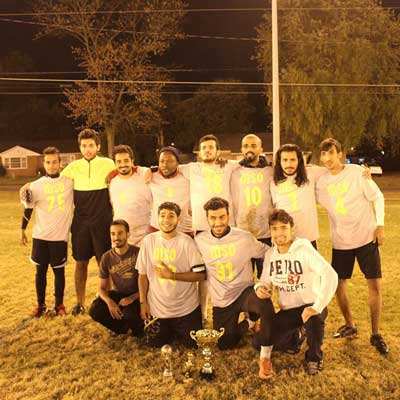 Photo courtesy of the Muslim Student Organization The Muslim Student Organization poses with the championship trophy for the Burrito Shack and Shogun Cup.
