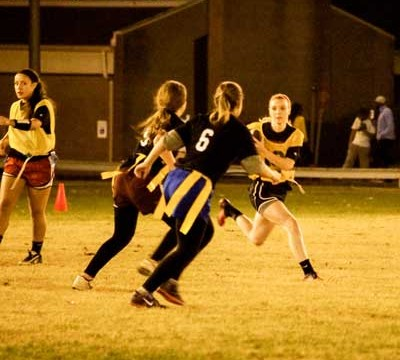 Zachary Maley/The News Kathryn Goetz, junior from St. Louis runs against Kappa Delta Monday night during Flag Football.